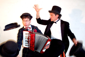 Woodhead on the accordian helps Waldo with his hats