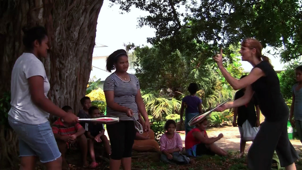 Demonstrating juggling clubs to the girls of Tonga. They get it quickly, and wow can they catch!